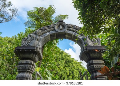 Kauai, Hawaii February 12, 2016 - Hand carved archway over a pathway on the grounds of the Himalayan Academy which is a Hindu monastery located on the island of Kauai, Hawaii.