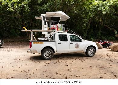 Kauai, Hawaii / USA - September 2, 2019: Kauai County lifeguard pickup truck near a lifeguard post. Kauai Lifeguard and Fire department.