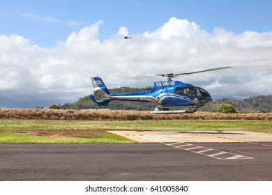 KAUAI, HAWAII, USA - SEPTEMBER 20, 2012 : Blue Hawaiian helicopter lands on heliport in Lihue. Blue Hawaiian is the only helicopter tour company serving all four major Hawaiian Islands