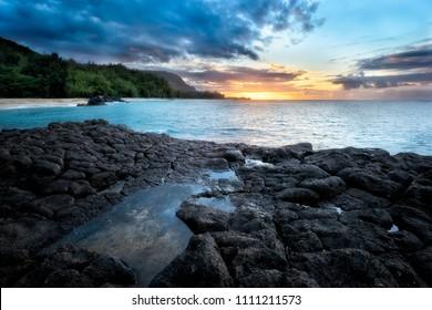 Kauapea Beach, also known as Seceret Beach, Kauai, Hawaii, at sunset