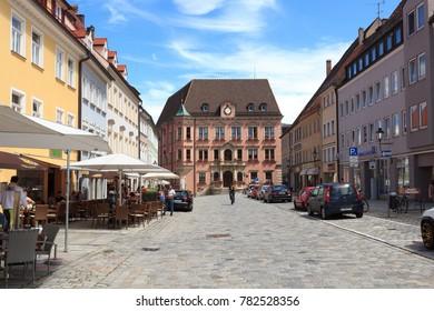 Kaufbeuren, Germany - July 29, 2017: Pedestrian zone with shops and people in old town Kaufbeuren. Kaufbeuren is an independent town in the Regierungsbezirk of Swabia, Bavaria.