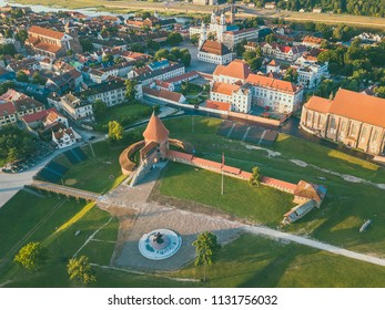 """Kaunas castle and """"Freedom Warrior"""" sculpture in Kaunas, Lithuania. Drone aerial view. Summer sunrise."""