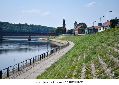 Kaunas city river Nemunas promenade in summer UNESCO city in Baltic states Lithuania waterfront background town downtown viewpoint on historic UNESCO Lithuanian city, bridge and hill of Kaunas Lietuva