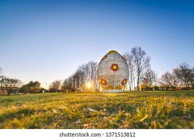 KAUNAS, LITHUANIA - APRIL  14, 2019: Giant Easter egg in Kaunas Confluence park, Lithuania. Spring sunset.
