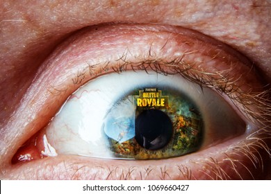 Kaunas, Lithuania - April 15, 2018: Fortnite game logo reflection on eye. Fortnite is one of the most popular battle royale games online.
