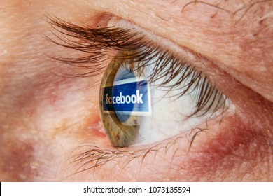 Kaunas, Lithuania - April 18, 2018: Facebook logo reflection in eye. Addiction of social media