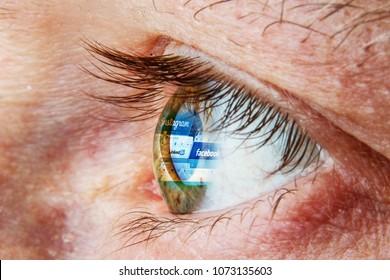 Kaunas, Lithuania - April 18, 2018: Facebook logo reflection in eye. Addiction of social media