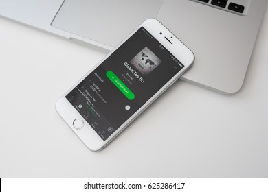 KAUNAS, LITHUANIA - APRIL 20, 2017: Control music at home with Sptify app on mobile. Spotify service developed by startup Spotify AB in Stockholm, Sweden