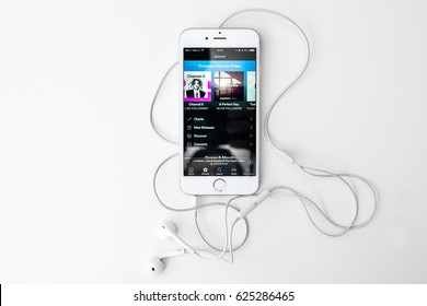 KAUNAS, LITHUANIA - APRIL 20, 2017: Playing music on iPhone 6S. Spotify is a music, podcast, and video streaming service, officially launched on 7 October 2008.