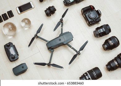 KAUNAS, LITHUANIA - APRIL 24, 2017: Photography equipment on wooden background: DSLR camera Nikon D810, drone DJI Mavic Pro, iPhone 6S lenses and other stuff