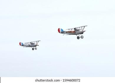 KAUNAS / LITHUANIA - August 10, 2019: two Nieuport 24 vintage aircraft flight display at air show in Aleksotas airfield, Kaunas, Lithuania