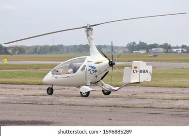 KAUNAS / LITHUANIA - August 10, 2019: Autogyro Calidus LY-BBA taxiing at 100 years Lithuanian aviation air show in Aleksotas airfield