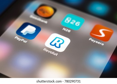 KAUNAS, LITHUANIA - DECEMBER 23, 2017: Revolut app logo. Revolut is a digital banking alternative that includes a pre-paid debit card, currency exchange, and peer-to-peer payments.