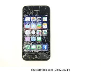 KAUNAS, LITHUANIA - DECEMBER, 26, 2015: Cracked screen smartphone. But still working. Broken iphone 4