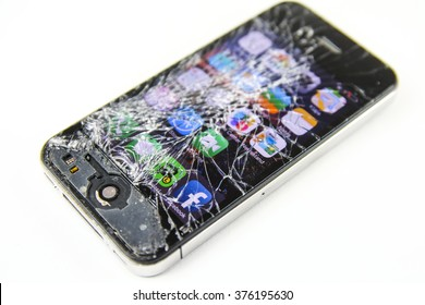 KAUNAS, LITHUANIA - FEBRUARY, 13, 2016: Screen broken smartphone. Broken Iphone 4. Broken and working phone