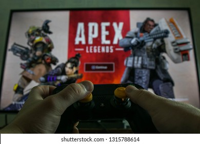 KAUNAS, LITHUANIA - FEBRUARY 17, 2019: Apex Legends battle royale video game. PS4 controller and popular video game in the background