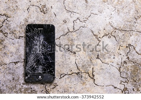 KAUNAS, LITHUANIA - FEBRUARY 8, 2016: Fallen on floor and broken smartphone. Screen cracked iphone