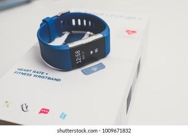 KAUNAS, LITHUANIA - JANUARY 25, 2018: Unboxing Fitbit Charge 2. This ia heart rate and fitness wristband that tracks activity.