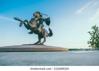"KAUNAS, LITHUANIA - JULY 11, 2018: ""Freedom Warrior"" sculpture in Kaunas, Lithuania. Summer sunrise."
