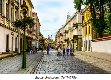 Kaunas, Lithuania - July 23, 2017: Panoramic view of Vilnius street (Vilniaus gatvé) in Kaunas old town. Tourist walking by the medieval street