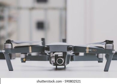 KAUNAS, LITHUANIA - MARCH 1, 2017: DJI Mavic Pro quadcopter on white background. The Mavic is a new drone design by DJI, which is more portable than older models