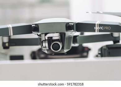 KAUNAS, LITHUANIA - MARCH 1, 2017: DJI Mavic Pro quadcopter and accessories on white background. The Mavic is a new drone design by DJI, which is more portable than older models