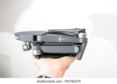 KAUNAS, LITHUANIA - MARCH 1, 2017: DJI Mavic Pro quadcopter in hand. The Mavic is a new drone design by DJI, which is more portable than older models
