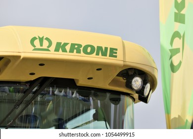 Kaunas, Lithuania - March 23: Krone tractor and logo on March 23, 2018 in Kaunas, Lithuania. Maschinenfabrik Bernard Krone GmbH is one of Europes foremost producers of forage harvesters.