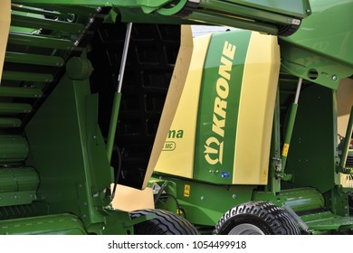 Kaunas, Lithuania - March 23: Krone tractor and logo on March 23, 2018 in Kaunas, Lithuania. Maschinenfabrik Bernard Krone GmbH is one of Europe's foremost producers of forage harvesters.