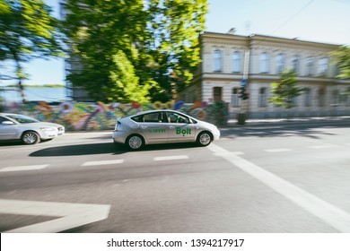 KAUNAS, LITHUANIA - MAY 09, 2019: Motion of Bolt car on the street. Formerly known as Taxify, is an international transportation network company founded and headquartered in Tallinn, Estonia