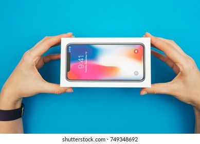 KAUNAS, LITHUANIA - NOVEMBER 05, 2017: Unboxing a new Apple Iphone X flagship smartphonee. Latest Apple Iphone 10 mobile phone model