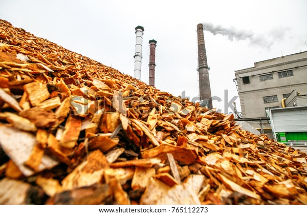 KAUNAS, LITHUANIA - NOVEMBER 22, 2017: Biomass energy factory. The station uses waste wood biomass as an energy source, and provides electricity and heat. Ecological recycling factory