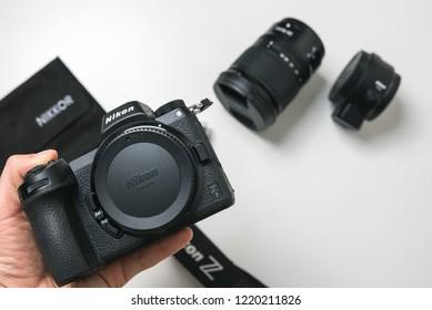 KAUNAS, LITHUANIA - OCTOBER 30, 2018: Holing in hand new Nikon Z7 camera. Its a new 45.7MP full-frame mirrorless camera