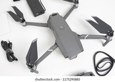 KAUNAS, LITHUANIA - SEPTEMBER 9, 2018: DJI Mavic 2 Pro quadcopter and accessories on white background. The Mavic 2 is a new drone design by DJI