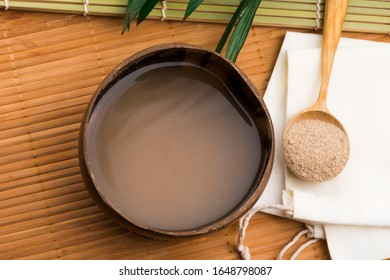 Kava drink made from the roots of the kava plant mixed with water - Shutterstock ID 1648798087