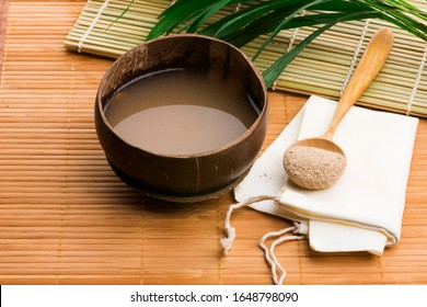 Kava drink made from the roots of the kava plant mixed with water - Shutterstock ID 1648798090