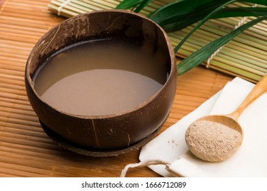 Kava drink made from the roots of the kava plant mixed with water - Shutterstock ID 1666712089