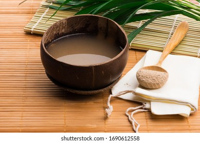 Kava drink made from the roots of the kava plant mixed with water - Shutterstock ID 1690612558