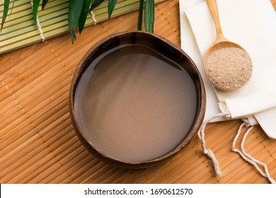 Kava drink made from the roots of the kava plant mixed with water - Shutterstock ID 1690612570