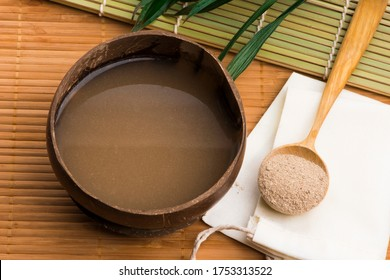 Kava drink made from the roots of the kava plant mixed with water - Shutterstock ID 1753313522