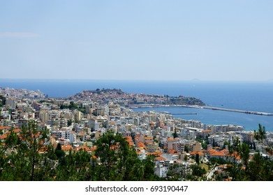Kavala, East Macedonia and Thrace, Greece. A city in northern Greece, in the Macedonia-Thrace region, located on the Aegean Sea. Top view of the city, harbor and sea.