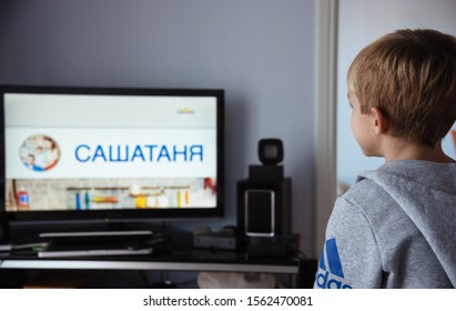 Kavala, Greece - 15 November, 2019: Little kid watching Russian series on TV.