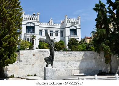 KAVALA, GREECE - JUNE 13: Statue of Goddess Nike in front of war memorial and historic town hall, on June 13, 2019 in Kavala, Greece