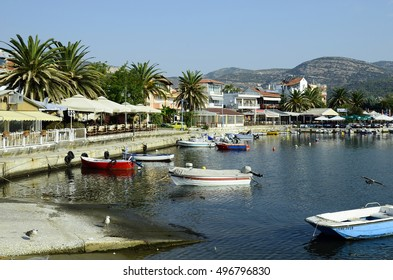 KAVALA, GREECE - SEPTEMBER 15: Fishing boats and restaurants in the tiny harbor of Perigiali in the city in Eastmacedonia, on September 15, 2016 in Kavala, Greece