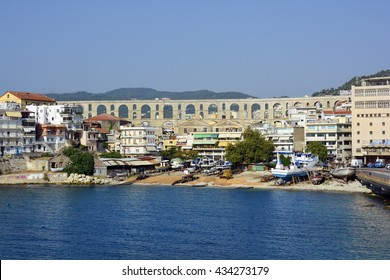 KAVALA, GREECE - SEPTEMBER 18: Cityscape with landmark medieval aqueduct Kamares, wharf and different buildings on aegean sea, on September 18, 2015 in Kavala, Greece