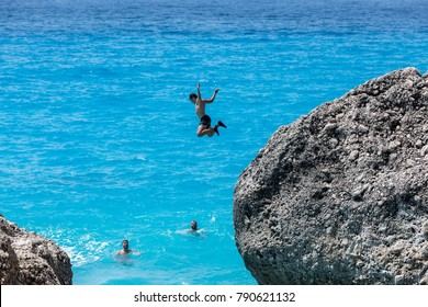 Kavalikefta Lefkada, Greece - July 15, 2017: People to jump playing in the sea at the Kavalikefta Beach in Lefkada Island, Greece