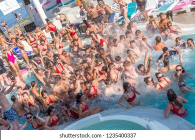 KAVOS,CORFU/GREECE- August 28 ,2018: Young Brits partying at one of the many pools of Kavos resort.Kavos is a popular resort with young holidaymakers from Britain.