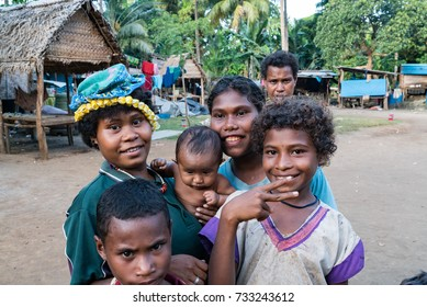 KAWA, TROBRIAND ISLANDS, PAPUA NEW GUINEA - NOVEMBER 13, 2016:  Young indigenous tribal children on the poverty stricken island of Kawa in the Trobriand islands of Papua New Guinea.