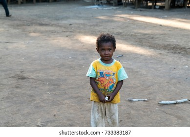 KAWA, TROBRIAND ISLANDS, PAPUA NEW GUINEA - NOVEMBER 13, 2016:  An unidentified indigenous tribal child living in poverty on a small island in the Trobriand Islands Papua New Guinea.
