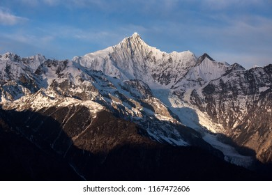 Kawagebo Peak, unclimbed summit which is part of Meili Xue Shan - Snow Mountain range in the Yunnan province of China. Also pictured Mingyong Glacier, the lowest altitude glacier in China. Ice Cliff